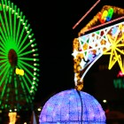 Illuminations of a Ferris wheel and the park